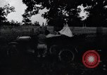 Image of camping in car United States USA, 1920, second 18 stock footage video 65675031931