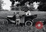 Image of camping in car United States USA, 1920, second 20 stock footage video 65675031931