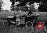 Image of camping in car United States USA, 1920, second 21 stock footage video 65675031931