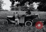 Image of camping in car United States USA, 1920, second 22 stock footage video 65675031931