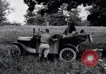 Image of camping in car United States USA, 1920, second 24 stock footage video 65675031931