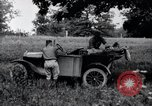 Image of camping in car United States USA, 1920, second 25 stock footage video 65675031931