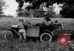Image of camping in car United States USA, 1920, second 26 stock footage video 65675031931