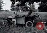 Image of camping in car United States USA, 1920, second 27 stock footage video 65675031931