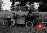 Image of camping in car United States USA, 1920, second 28 stock footage video 65675031931