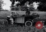 Image of camping in car United States USA, 1920, second 29 stock footage video 65675031931