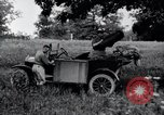 Image of camping in car United States USA, 1920, second 30 stock footage video 65675031931