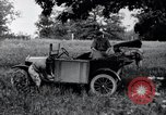 Image of camping in car United States USA, 1920, second 32 stock footage video 65675031931