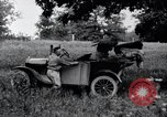 Image of camping in car United States USA, 1920, second 33 stock footage video 65675031931