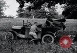 Image of camping in car United States USA, 1920, second 34 stock footage video 65675031931