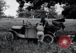 Image of camping in car United States USA, 1920, second 35 stock footage video 65675031931
