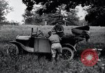 Image of camping in car United States USA, 1920, second 36 stock footage video 65675031931