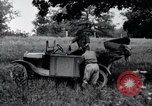 Image of camping in car United States USA, 1920, second 37 stock footage video 65675031931