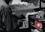 Image of camping in car United States USA, 1920, second 54 stock footage video 65675031931