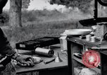 Image of camping in car United States USA, 1920, second 56 stock footage video 65675031931