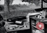 Image of camping in car United States USA, 1920, second 57 stock footage video 65675031931
