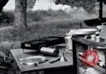 Image of camping in car United States USA, 1920, second 59 stock footage video 65675031931