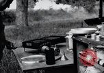 Image of camping in car United States USA, 1920, second 62 stock footage video 65675031931