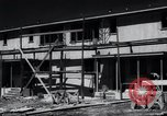 Image of construction of houses United States USA, 1941, second 16 stock footage video 65675031938