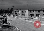 Image of construction of houses United States USA, 1941, second 30 stock footage video 65675031938