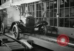 Image of Chassis of Model T Fifteen Millionth car Highland Park Michigan USA, 1927, second 21 stock footage video 65675031965
