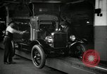 Image of Body assembly of Model T Fifteen Millionth car Highland Park Michigan USA, 1927, second 17 stock footage video 65675031966