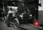 Image of Body assembly of Model T Fifteen Millionth car Highland Park Michigan USA, 1927, second 22 stock footage video 65675031966