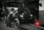 Image of Body assembly of Model T Fifteen Millionth car Highland Park Michigan USA, 1927, second 23 stock footage video 65675031966