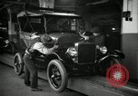 Image of Body assembly of Model T Fifteen Millionth car Highland Park Michigan USA, 1927, second 30 stock footage video 65675031966