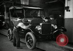 Image of Body assembly of Model T Fifteen Millionth car Highland Park Michigan USA, 1927, second 31 stock footage video 65675031966
