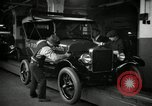 Image of Body assembly of Model T Fifteen Millionth car Highland Park Michigan USA, 1927, second 33 stock footage video 65675031966