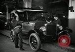 Image of Body assembly of Model T Fifteen Millionth car Highland Park Michigan USA, 1927, second 35 stock footage video 65675031966