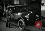 Image of Body assembly of Model T Fifteen Millionth car Highland Park Michigan USA, 1927, second 39 stock footage video 65675031966