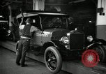 Image of Body assembly of Model T Fifteen Millionth car Highland Park Michigan USA, 1927, second 42 stock footage video 65675031966