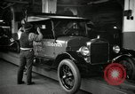 Image of Body assembly of Model T Fifteen Millionth car Highland Park Michigan USA, 1927, second 44 stock footage video 65675031966