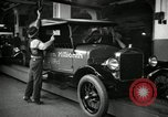 Image of Body assembly of Model T Fifteen Millionth car Highland Park Michigan USA, 1927, second 51 stock footage video 65675031966