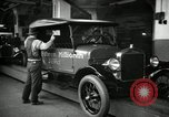 Image of Body assembly of Model T Fifteen Millionth car Highland Park Michigan USA, 1927, second 52 stock footage video 65675031966