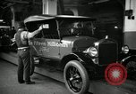 Image of Body assembly of Model T Fifteen Millionth car Highland Park Michigan USA, 1927, second 53 stock footage video 65675031966