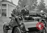Image of Henry Ford and son, Edsel Ford pose in early model cars Dearborn Michigan USA, 1933, second 2 stock footage video 65675032016