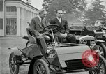 Image of Henry Ford and son, Edsel Ford pose in early model cars Dearborn Michigan USA, 1933, second 4 stock footage video 65675032016