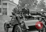Image of Henry Ford and son, Edsel Ford pose in early model cars Dearborn Michigan USA, 1933, second 5 stock footage video 65675032016