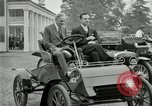 Image of Henry Ford and son, Edsel Ford pose in early model cars Dearborn Michigan USA, 1933, second 8 stock footage video 65675032016