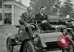 Image of Henry Ford and son, Edsel Ford pose in early model cars Dearborn Michigan USA, 1933, second 9 stock footage video 65675032016