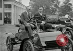 Image of Henry Ford and son, Edsel Ford pose in early model cars Dearborn Michigan USA, 1933, second 11 stock footage video 65675032016