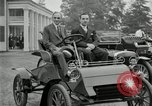 Image of Henry Ford and son, Edsel Ford pose in early model cars Dearborn Michigan USA, 1933, second 12 stock footage video 65675032016