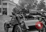 Image of Henry Ford and son, Edsel Ford pose in early model cars Dearborn Michigan USA, 1933, second 13 stock footage video 65675032016
