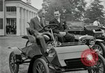 Image of Henry Ford and son, Edsel Ford pose in early model cars Dearborn Michigan USA, 1933, second 16 stock footage video 65675032016
