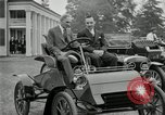 Image of Henry Ford and son, Edsel Ford pose in early model cars Dearborn Michigan USA, 1933, second 17 stock footage video 65675032016