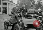 Image of Henry Ford and son, Edsel Ford pose in early model cars Dearborn Michigan USA, 1933, second 18 stock footage video 65675032016