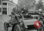 Image of Henry Ford and son, Edsel Ford pose in early model cars Dearborn Michigan USA, 1933, second 19 stock footage video 65675032016